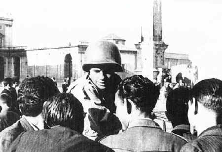 Alfonso Felici, 3rd Bn, 349th, gives the news to the civilians on liberations day in ROME, 4 june 1944.  He's in the piazza in front of St. John in Laterano